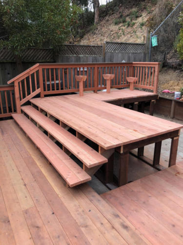 Finished deck showing stairs leading to hot tub insert